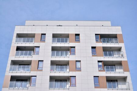 New building condominium. Modern apartment complex exterior. 免版税图像