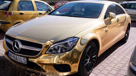 Warsaw, Poland. March 15, 2020. Chrome gold Mercedes car.