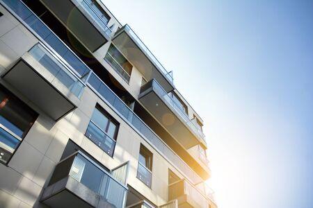 Modern apartment building exterior concept. Sunshine sun flare.