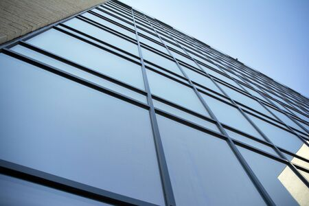 Abstract texture and blue glass facade in modern office building.