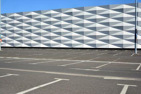 Empty parking lot by a shopping center shut down due to Coronavirus Covid 19 Quarantine social distancing