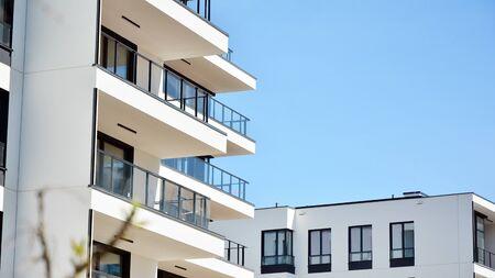 Modern condo building with big windows and modern facade.