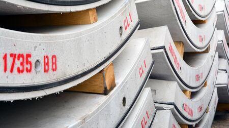 Concrete underground tunnel segments. Storage place concrete plant.