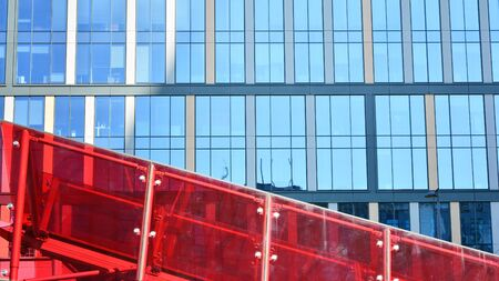 Modern Architecture. Glass facade on the blue sky. Corporate concept - detail of modern glass building.