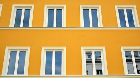 Beautiful yellow facade, restored building exterior in old town.