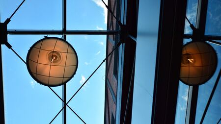 Glass ceiling with lamps in revitalized building.