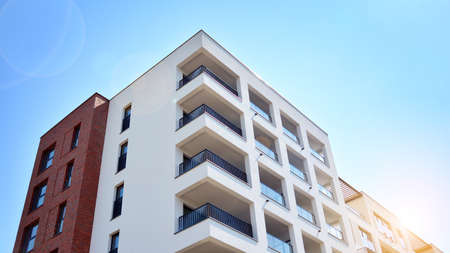 Contemporary residential building exterior in the daylight. Modern and new apartment building. Multistoried, modern, new and stylish living block of flats.