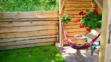 The garden wooden house decorated with summer flowers