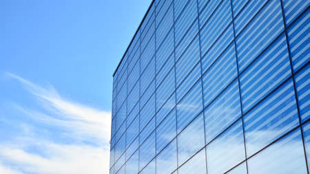 Commercial building close up. Abstract texture of blue glass modern building. Business background.