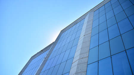 Glass curtain wall of modern office building. Modern office building on a clear sky background.