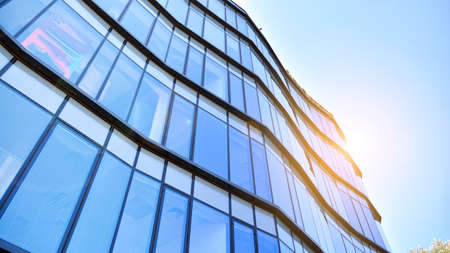 Glass curtain wall of modern office building. Modern office building on a clear sky background. Archivio Fotografico