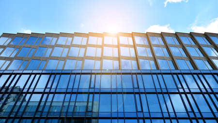 Office building, details of blue glass wall and sun reflections. Imagens