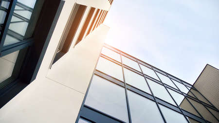 Modern apartment buildings on a sunny day with a blue sky. Facade of a modern apartment building. Glass surface with sunlight. Imagens