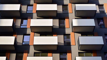 Facade of a modern apartment building with balconies. No people. Real estate business concept. Stok Fotoğraf