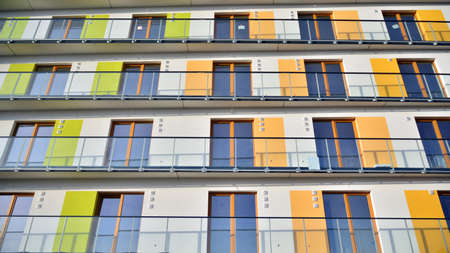 Modern apartment building with colorful facade. Beautiful facade in a modern residential building. Residential complex in city.