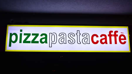 Warsaw, Poland. 10 January 2021. Sign Pizza Pasta Caffe. Company signboard Pizza Pasta Caffe