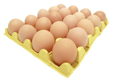 eggtray: Image of a  yellow eggtray containing twenty eggs on a white background. Clipping path included. Stock Photo