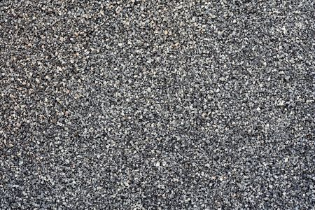 grey gravel or small grey crushed stones photo