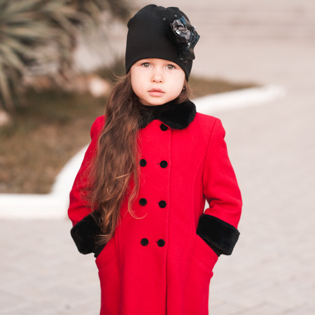 trendy girl: Cute kid girl 5-6 year old wearing stylish outdoors. Looking at camera.