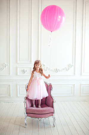 Happy Kid Girl 4 5 Year Old Having Fun In Room. Holding Big Pink.. Stock  Photo, Picture And Royalty Free Image. Image 66537643.