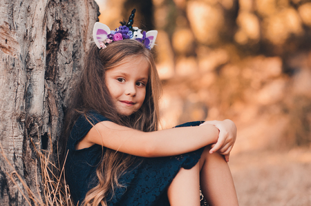 387489181baa Cute Baby Girl 4-5 Year Old Wearing Stylish Dress And Headband ...