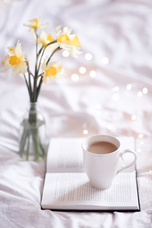 Good morning with fresh cup of coffee and reading in bed. 写真素材 - 106232761