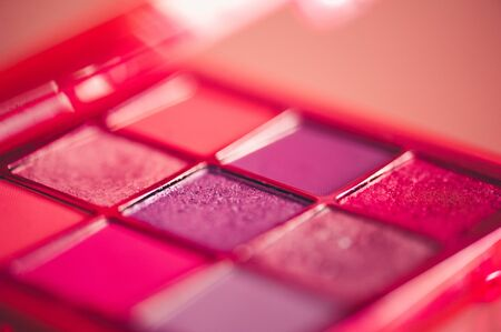 Makeup palette with pink glitter eye shadows closeup. Selective focus. 写真素材 - 131956657