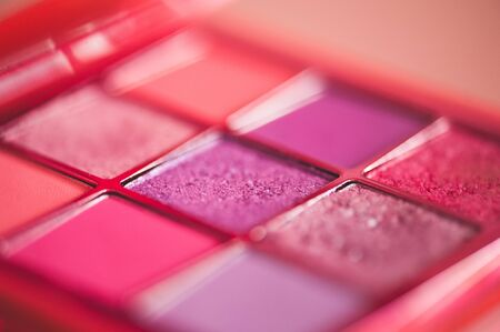 Eye shadow palette in pink shades closeup. Make up product. Selective focus. 写真素材 - 131955546