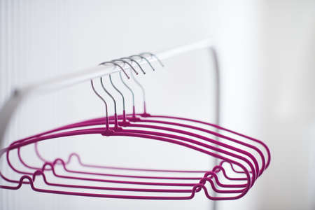 Empty hangers on rack in room close up. Selective focus.