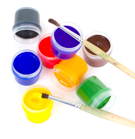 gouache and brushes isolated on white Stock Photo