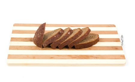 hardboard: sliced bread on a hardboard isolated on white