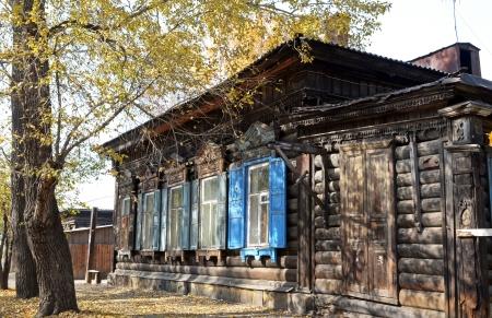 architectonics: The wooden house with window shutters on Irkutsk street Stock Photo