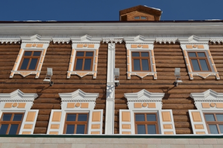 architectonics: Front of wooden house with shutters and carving frames  Irkutsk  Stock Photo