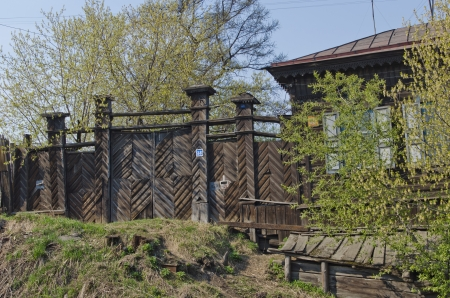 wicket: Old wooden gate and wicket door on the private housing street  Irkutsk