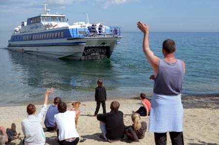 escorted: Motor vessel departs from the coast  lake Baikal