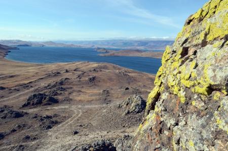 Bright lichen on the rock on island Olkhon  Baikal Stock Photo - 17733501