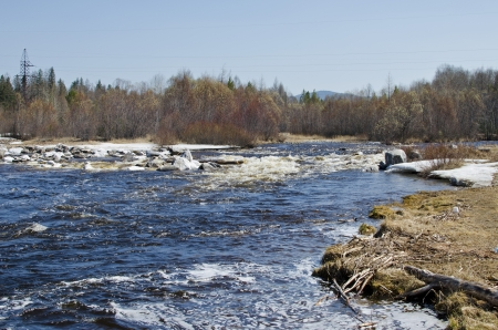 rages: Bystraya  Rapid  River with the remnants of the ice in the spring  Buryatia