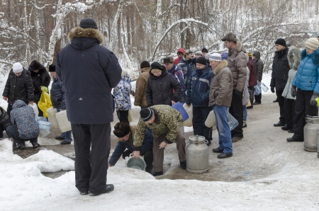 People take water in the Holy well spring on Epiphany-day  Irkutsk region, Russia