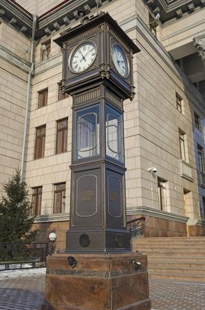 utterance: Street clock on a pedestal in Krasnoyarsk, Russia Stock Photo