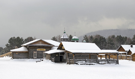 wicket gate: Wooden houses in village in winter