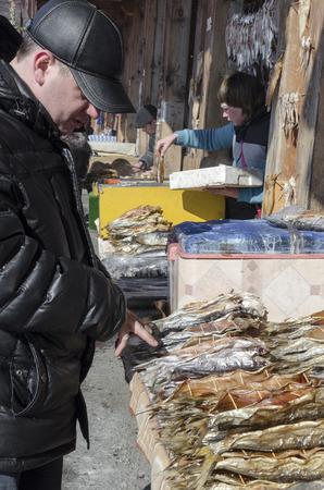 listvyanka: Man choose cisco  Fish market in Listvyanka, Lake Baikal