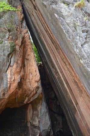 cleft: Smooth steep cleft on the Phing Kan Island. Phang Nga Bay, Thailand Stock Photo