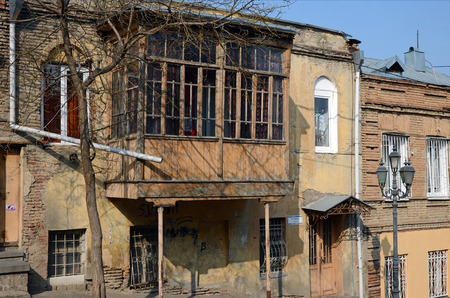 singularity: House with a traditional balcony in Tbilisi. Old city