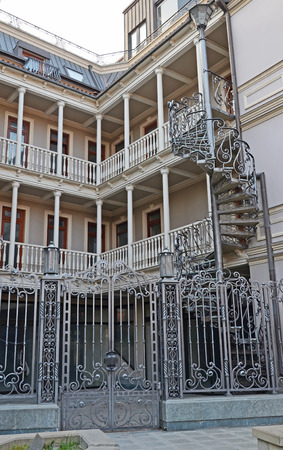 noteworthy: House with traditional balconies and wroughtiron spiral staircase. Tbilisi Editorial