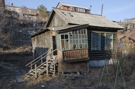 rickety: Old rickety launched wooden house with ladder and porch