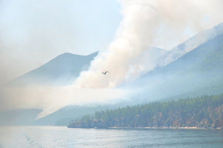 eddy: Forest fire on the western shore of Lake Baikal in Sandy Bay area Stock Photo
