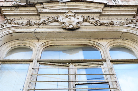 noteworthy: Sculptural decoration of window on facade of an old apartment building in Tbilisi, Georgia Stock Photo