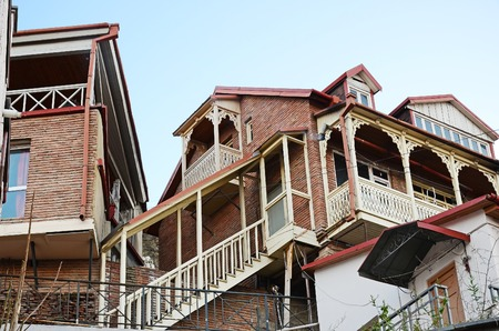 noteworthy: Traditional houses with wooden carved balcony and staircase.  Tbilisi, Georgia