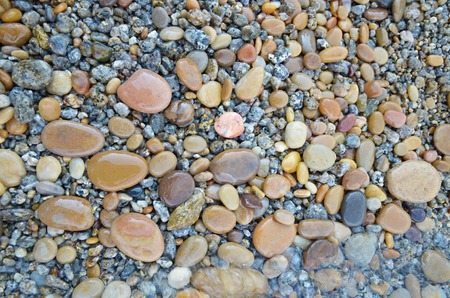 Colored smooth stones polished by Baikal Lake Stock Photo
