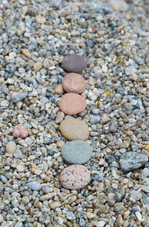 skillfully: Colored smooth stones polished by Baikal Lake. Focus on first